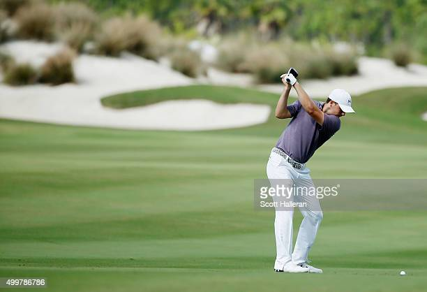 Jordan Spieth of the United States hits his second shot on the third hole during the first round of the Hero World Challenge at Albany The Bahamas on...