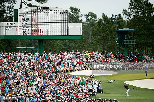 Jordan Spieth of the United States hits his tee shot on the third hole as Justin Rose of England and Jonas Blixt of Sweden look on during the final...