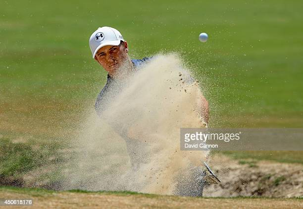 Jordan Spieth of the United States hits his third shot from a bunker on the fourth hole during the third round of the 114th US Open at Pinehurst...