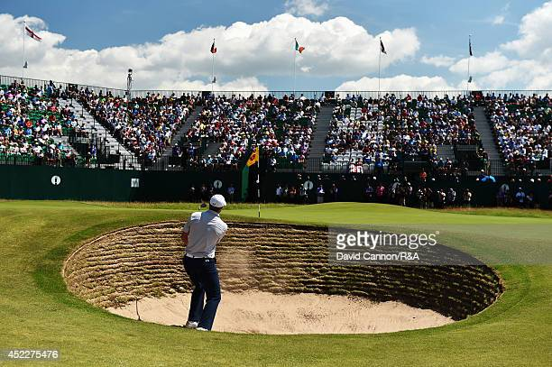 Jordan Spieth of the United States hits his third shot from a bunker on the 18th hole during the first round of The 143rd Open Championship at Royal...