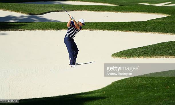 Jordan Spieth of the United States hits out of a bunker during practice prior to the 2016 Ryder Cup at Hazeltine National Golf Club on September 29...