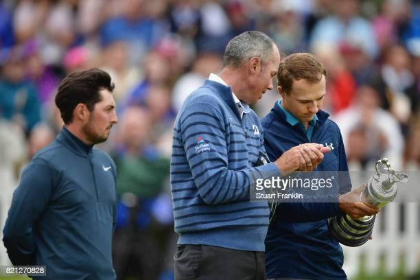 Jordan Spieth of the United States holds the Claret Jug alongside Matt Kuchar of the United States and Amateur Alfie Plant of England on the 18th...