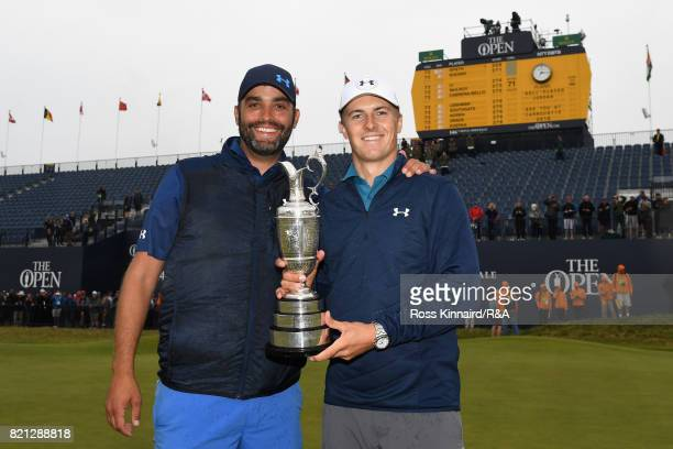 Jordan Spieth of the United States holds the Claret Jug and celebrates victory on the 18th green with caddie Michael Greller during the final round...