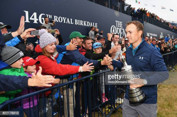 Jordan Spieth of the United States holds the Claret Jug as he greets fans after winning the 146th Open Championship at Royal Birkdale on July 23 2017...