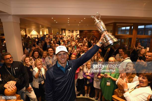 Jordan Spieth of the United States holds the Claret Jug in the clubhouse and is applauded by members of Royal Birkdale after the final round of the...