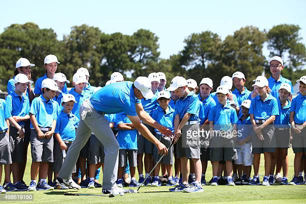 Jordan Spieth of the United States hosts a golf clinic for junior Australian golfers ahead of the 2015 Australian Open at The Australian Golf Course...