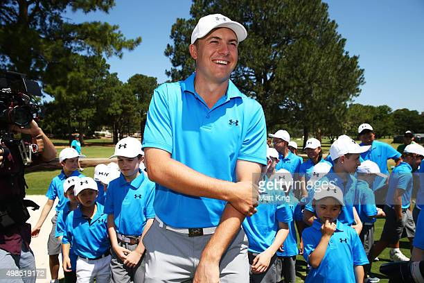 Jordan Spieth of the United States interacts with junior Australian golfers while hosting a golf clinic ahead of the 2015 Australian Open at The...