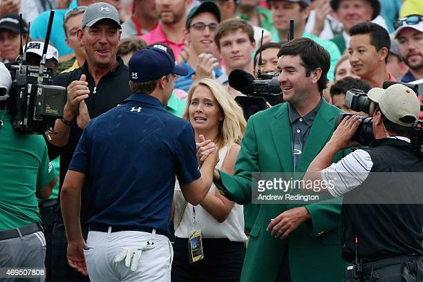 Jordan Spieth of the United States is greeted by Bubba Watson behind the 18th green after Spieth's fourstroke victory at the 2015 Masters Tournament...