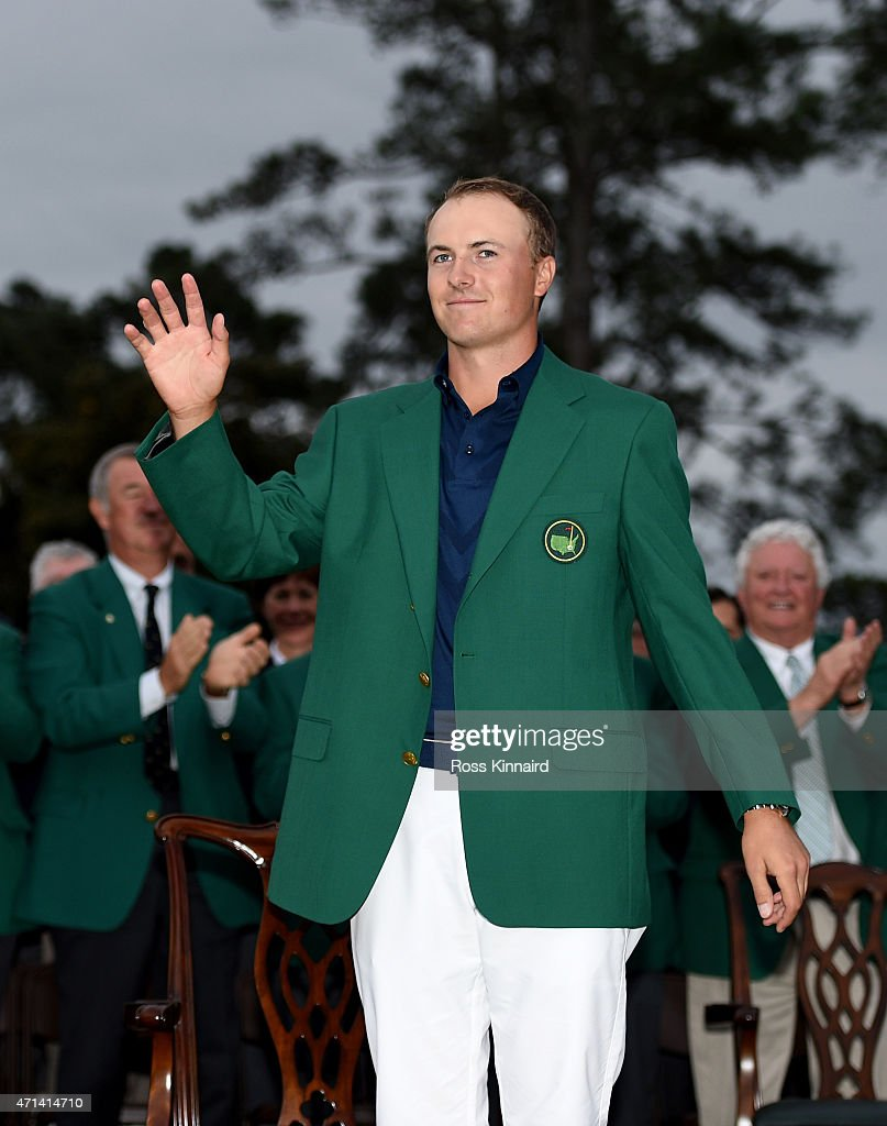 Jordan Spieth of the United States is presented with his Green Jacket after the final round of the 2015 Masters at Augusta National Golf Club on April 12, 2015 in Augusta, Georgia.