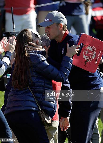 Jordan Spieth of the United States kisses Annie Verret during morning foursome matches of the 2016 Ryder Cup at Hazeltine National Golf Club on...
