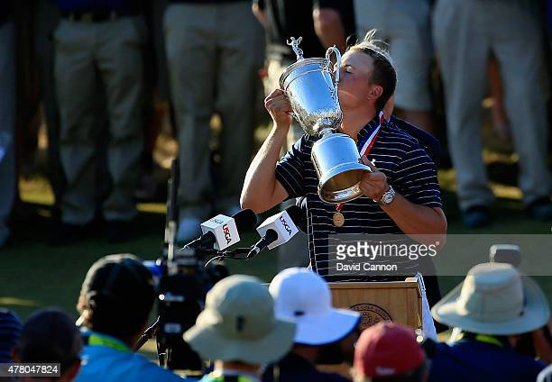 Jordan Spieth of the United States kisses the trophy after winning the 115th US Open Championship at Chambers Bay on June 21 2015 in University Place...