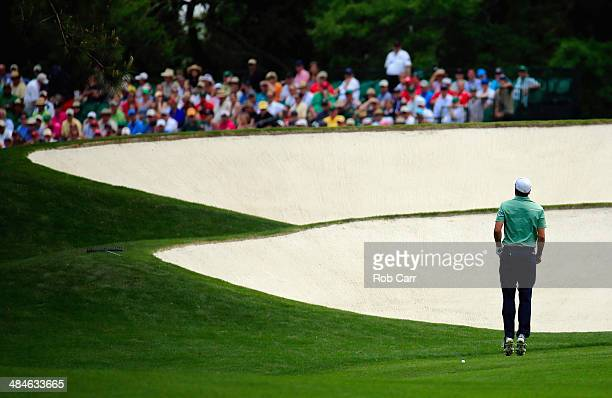 Jordan Spieth of the United States leaps in the air on the fifth hole during the final round of the 2014 Masters Tournament at Augusta National Golf...