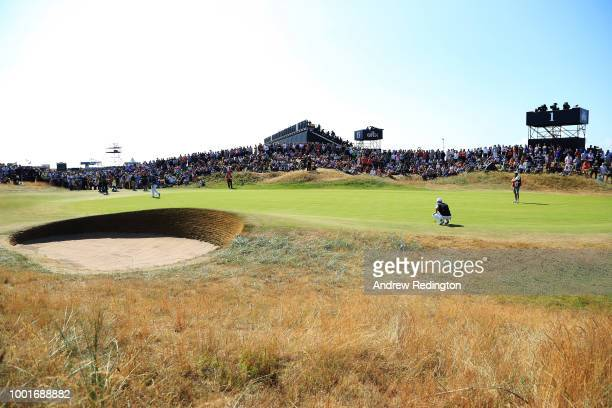 Jordan Spieth of the United States lines up a putt during the first round of the 147th Open Championship at Carnoustie Golf Club on July 19 2018 in...