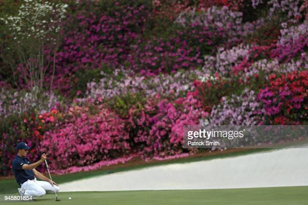 Jordan Spieth of the United States lines up a putt on the 13th hole during the first round of the 2018 Masters Tournament at Augusta National Golf...