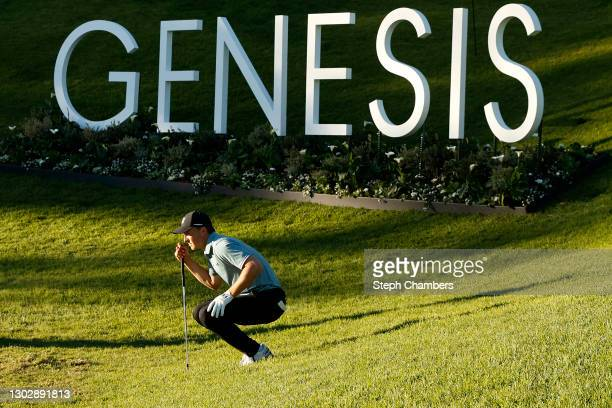 Jordan Spieth of the United States lines up a putt on the 18th green during the first round of The Genesis Invitational at Riviera Country Club on...