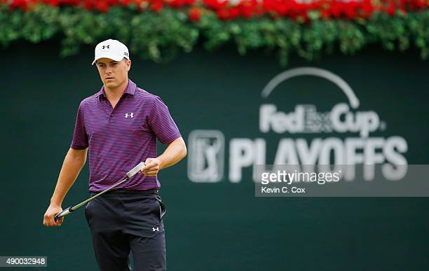 Jordan Spieth of the United States lines up a putt on the 18th green during the second round of the TOUR Championship By CocaCola at East Lake Golf...