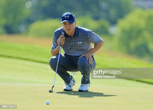 Jordan Spieth of the United States lines up a putt on the eighth green during the second round of the 2017 US Open at Erin Hills on June 16 2017 in...