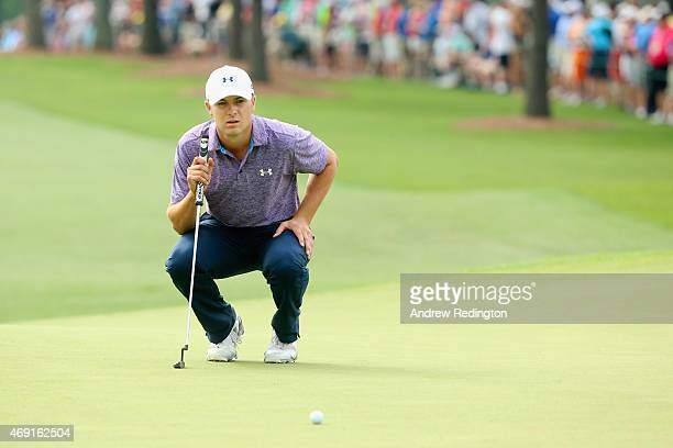 Jordan Spieth of the United States lines up a putt on the first green during the second round of the 2015 Masters Tournament at Augusta National Golf...