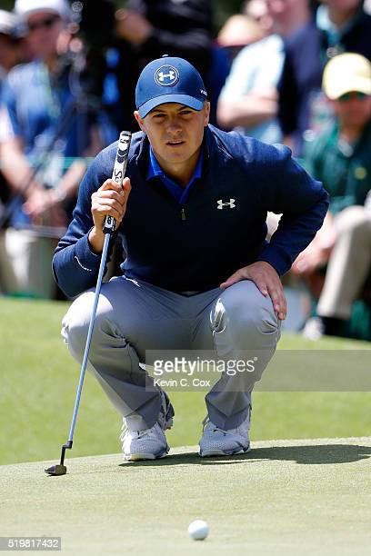 Jordan Spieth of the United States lines up a putt on the first green during the second round of the 2016 Masters Tournament at Augusta National Golf...