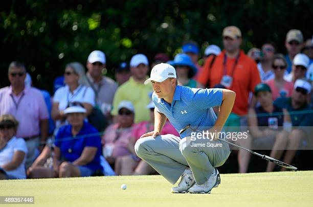 Jordan Spieth of the United States lines up a putt on the sixth green during the third round of the 2015 Masters Tournament at Augusta National Golf...