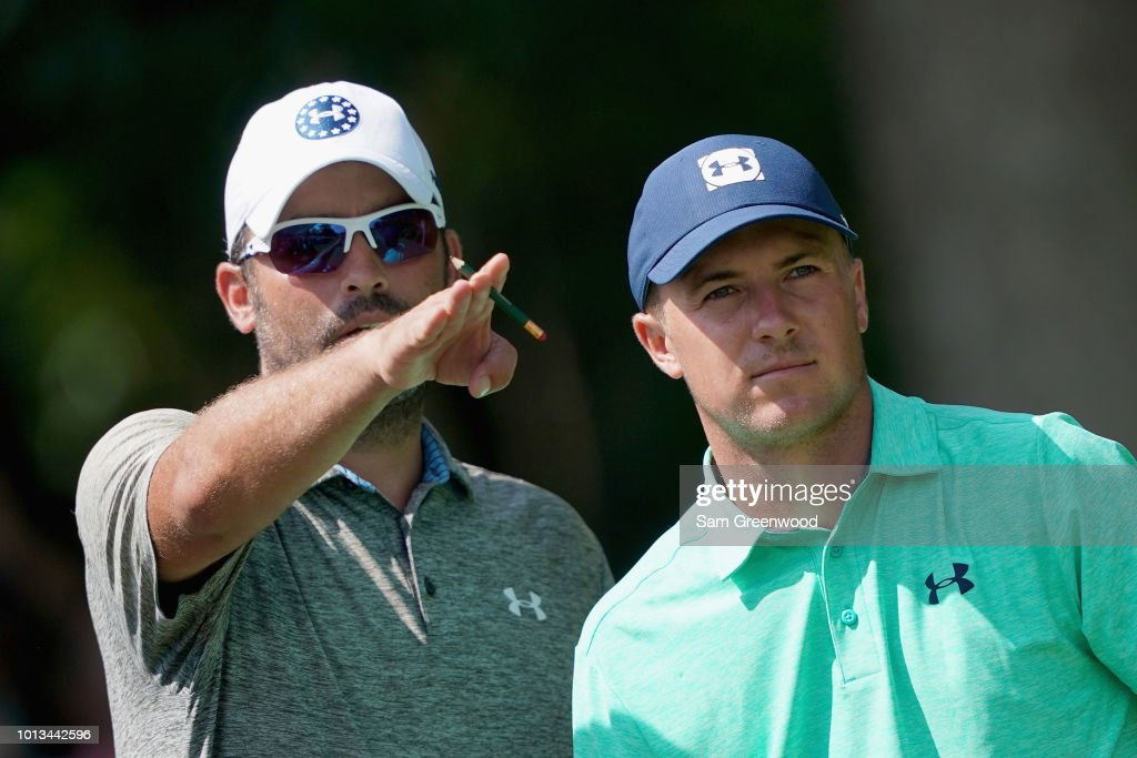 Jordan Spieth of the United States lines up a shot with caddie Michael Greller during a practice round prior to the 2018 PGA Championship at Bellerive Country Club on August 8, 2018 in St Louis, Missouri.