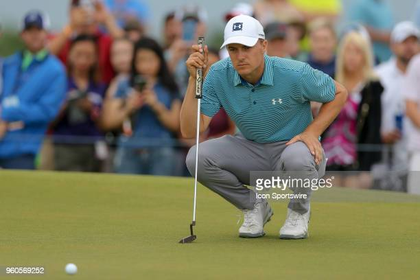 Jordan Spieth of the United States lines up his par putt on during the final round of the 50th annual ATT Byron Nelson on May 20 2018 at Trinity...
