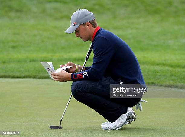 Jordan Spieth of the United States looks at his yardage book on the ninth green during morning foursome matches of the 2016 Ryder Cup at Hazeltine...