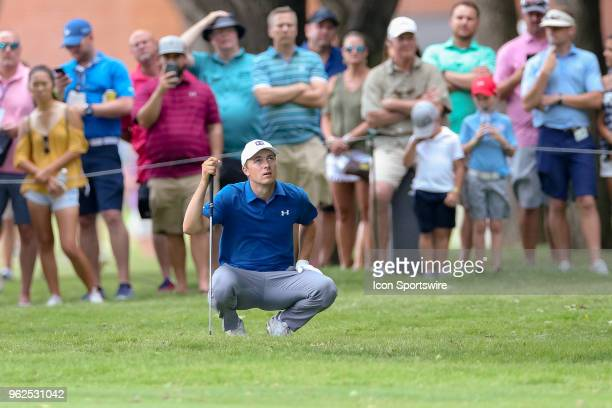 Jordan Spieth of the United States looks up at the trees obstructing his approach shot to during the second round of the Fort Worth Invitational on...