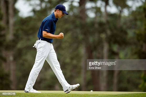 Jordan Spieth of the United States makes birdie on the third green during the final round of the 2015 Masters Tournament at Augusta National Golf...