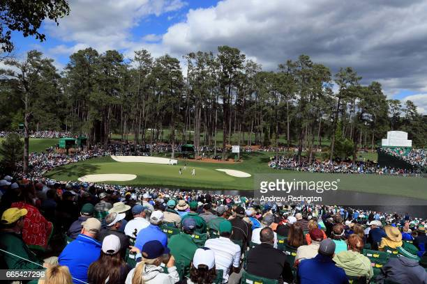 Jordan Spieth of the United States Matthew Fitzpatrick of England and Martin Kaymer of Germany play the 16th green during the first round of the 2017...