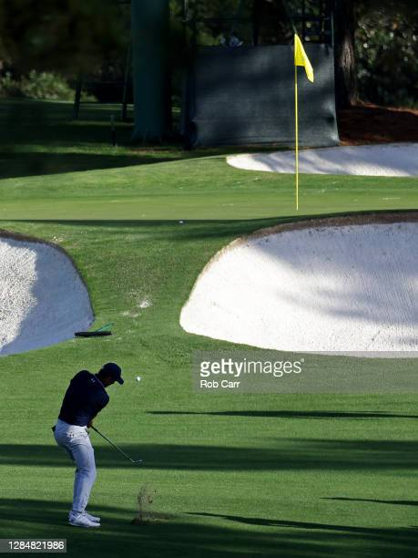 Jordan Spieth of the United States pitches on the seventh hole during a practice round prior to the Masters at Augusta National Golf Club on November...