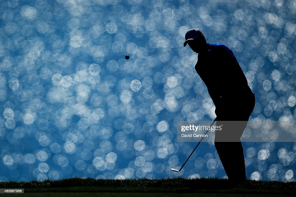 Jordan Spieth of the United States pitches to the 16th green during the second round of the 2015 PGA Championship at Whistling Straits on August 14, 2015 in Sheboygan, Wisconsin.
