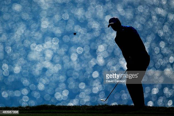 Jordan Spieth of the United States pitches to the 16th green during the second round of the 2015 PGA Championship at Whistling Straits on August 14,...