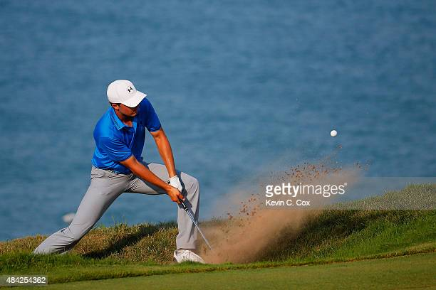 Jordan Spieth of the United States plays a bunker shot on the 16th hole during the final round of the 2015 PGA Championship at Whistling Straits on...