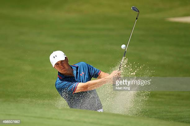 Jordan Spieth of the United States plays a bunker shot on the 8th hole during a practice round ahead of the 2015 Australian Open at The Australian...