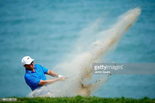 Jordan Spieth of the United States plays a bunker shot on the fourth hole during the final round of the 2015 PGA Championship at Whistling Straits on...
