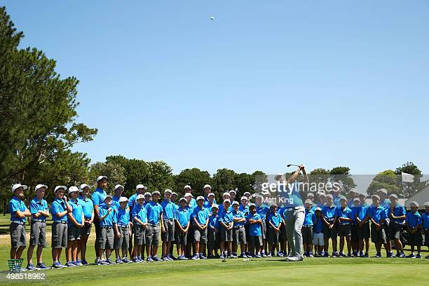 Jordan Spieth of the United States plays a pitch shot as he hosts a golf clinic for junior Australian golfers ahead of the 2015 Australian Open at...