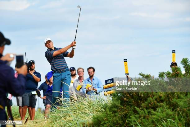 Jordan Spieth of the United States plays a shot after a penalty drop on the sixth hole during the final round of the 147th Open Championship at...