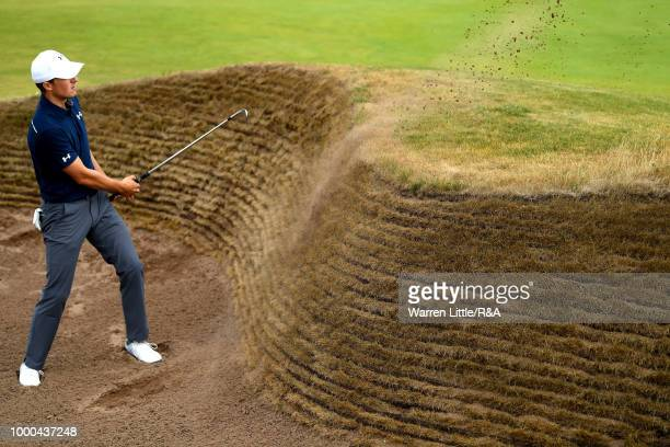 Jordan Spieth of the United States plays a shot from a bunker at the 14th green while practicing during previews to the 147th Open Championship at...
