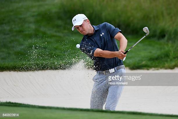 Jordan Spieth of the United States plays a shot from a bunker during a practice round prior to the US Open at Oakmont Country Club on June 15 2016 in...