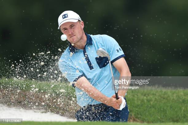 Jordan Spieth of the United States plays a shot from a bunker on the seventh hole during the first round of the Charles Schwab Challenge at Colonial...
