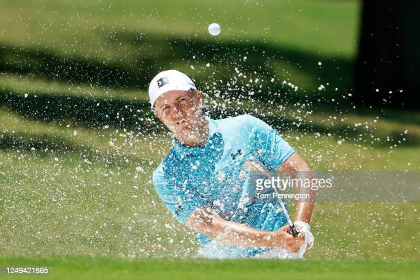 Jordan Spieth of the United States plays a shot from a bunker on the first hole during the third round of the Charles Schwab Challenge on June 13...