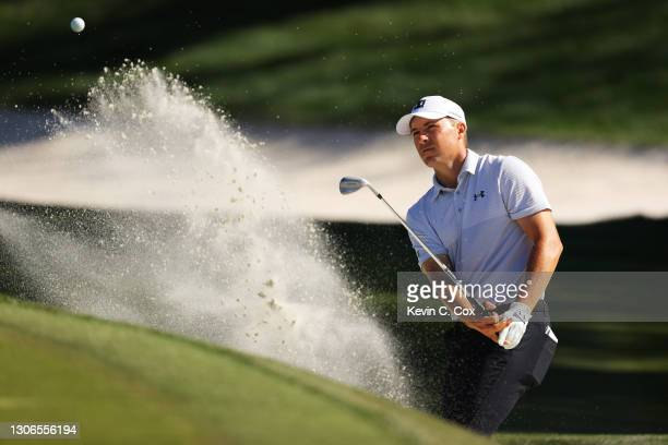 Jordan Spieth of the United States plays a shot from a bunker on the ninth hole during the first round of THE PLAYERS Championship on THE PLAYERS...
