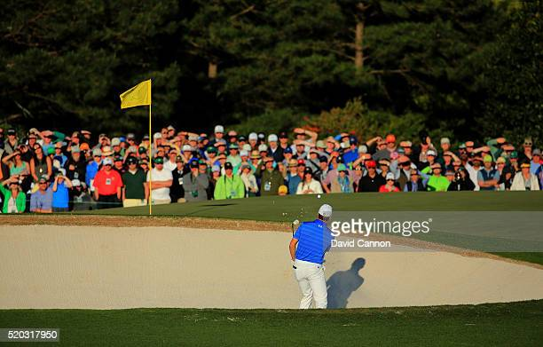 Jordan Spieth of the United States plays a shot from a bunker on the 13th hole during the final round of the 2016 Masters Tournament at Augusta...