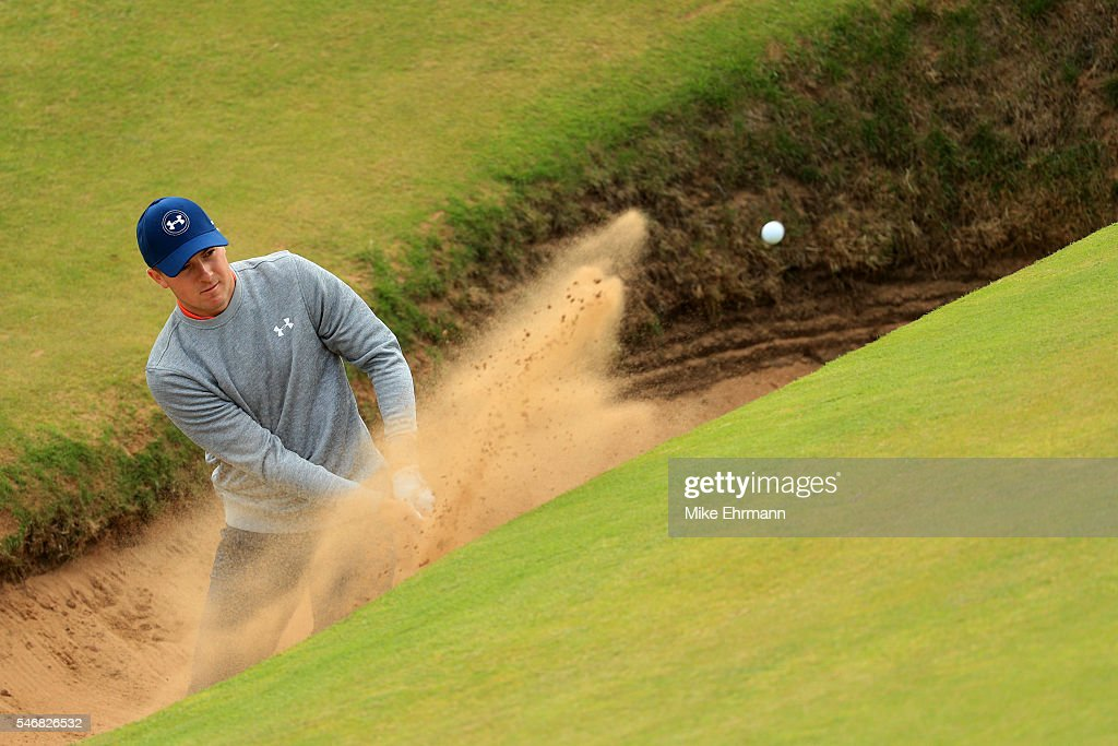 Jordan Spieth of the United States plays a shot from a bunker on the 8th hole during a practice round ahead of the 145th Open Championship at Royal Troon on July 13, 2016 in Troon, Scotland.