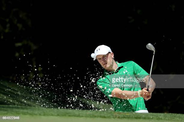 Jordan Spieth of the United States plays a shot from a bunker on the tenth hole during a practice round prior to the start of the 2017 Masters...