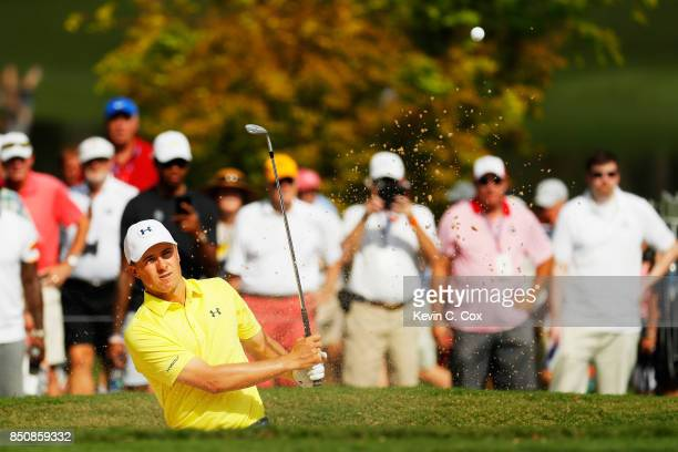 Jordan Spieth of the United States plays a shot from a bunker on the ninth hole during the first round of the TOUR Championship at East Lake Golf...