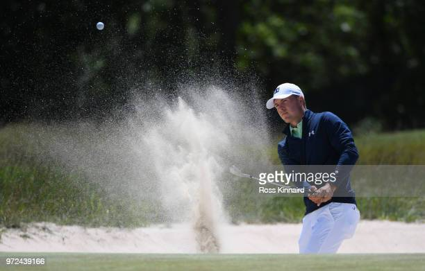 Jordan Spieth of the United States plays a shot from a bunker on the second hole during a practice round prior to the 2018 US Open at Shinnecock...