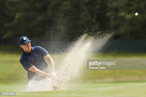 Jordan Spieth of the United States plays a shot from a bunker on the second hole during the second round of the 2018 US Open at Shinnecock Hills Golf...