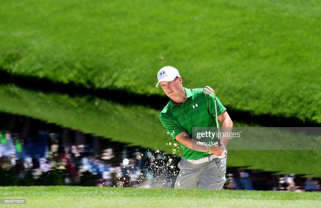 Jordan Spieth of the United States plays a shot from a greenside bunker on the 16th hole during a practice round prior to the start of the 2017 Masters Tournament at Augusta National Golf Club on April 4, 2017 in Augusta, Georgia.